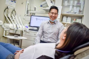 Sandstone Dental | North Calgary Dentist | Dr. Chris Lan Consulting with Patient