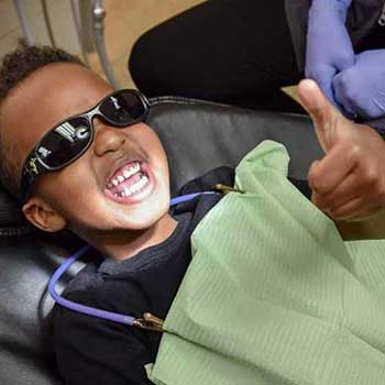 Sandstone Dental | North Calgary Dentist | Child Patient Giving Thumbs Up